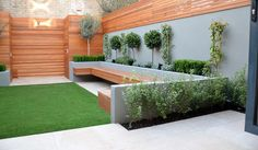 Lots of good inspiration - particular: Wood panel fences; Plasterboard render; lighting under bench