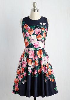 Musical performance requires lots of dedication - but this navy blue dress effortlessly outfits you in a beautifully dynamic design! With an orange, green, white and pink floral print, a golden zipper, and side pockets, this A-line turns your stage presence into a fashionably fortissimo affair!