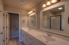 Fenway master bath with raised ceilings, cultured marble countertops, and chrome hardware.