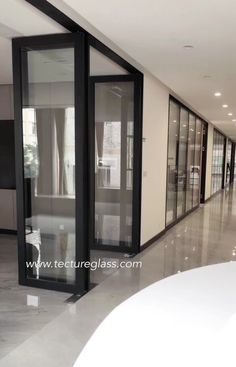Double glazed partition with black aluminum frame for corporate offices design. Corporate Offices, Corporate Office Design, Commercial Design, Commercial Interiors, Glass Partition Wall, Laminated Glass, Architects, Decoration, Frame