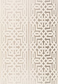 The patterning on this panel stripe wallcovering is derived from complex Moorish fretwork designs of interlocking forms. Its exotic geometry creates a dramatic look for walls in a neutral palette that is accented with metallic gold and silver.
