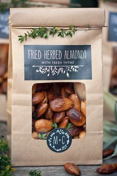A simple brown bag, cut-out hole to expose contents/line (seal) with clear wrap, add description, etc., garnish with a sprig of green. find recipe for almonds here: http://www.myownlabels.com/blog/fried-almond-wedding-favors/