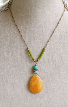 Skyler. Calcite gemstone,glass beaded rhinestone necklace. Tiedupmemories. $52.00, via Etsy.