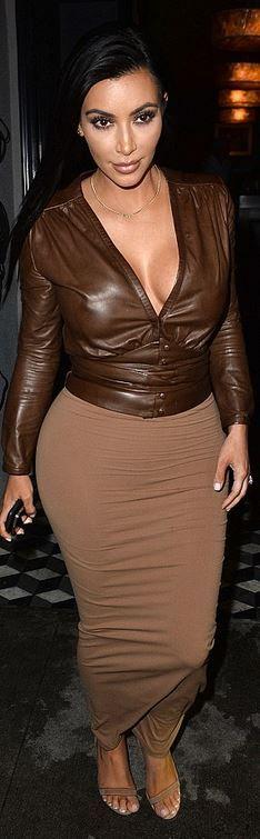 Who made  Kim Kardashian's brown skirt, leather shirt, and tan sandals?