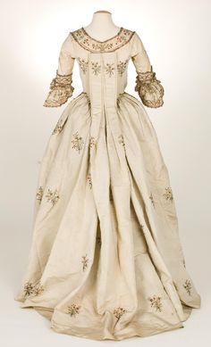 Rear view Sacque gown a la Piedmontese, ca. 1780, Italy (?), plain cream ribbed silk, metallic and silk embroidery. Metallic lace borders all the embroidery elements, with additional spangles adding even more sparkle to the design.