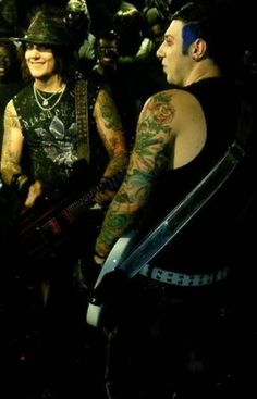 Synyster Gates and Zacky Vengeance ~ Avenged Sevenfold. I love the grin that says Syn is up to no good. ;-)