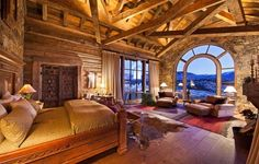 Wouldn't it be lovely to wake up to the beautiful view of snow-capped mountains like in this bedroom?