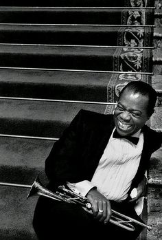 Louis Armstrong (August 1901 – July Satchmo or Pops, was an American jazz trumpeter, singer, and an influential figure in jazz music.Louis Armstrong on the MGM set of 'High Society', 1956 Louis Armstrong, Humphrey Bogart, Jazz Musicians, Famous Musicians, Jazz Blues, High Society, Music Icon, Famous Faces, Black White