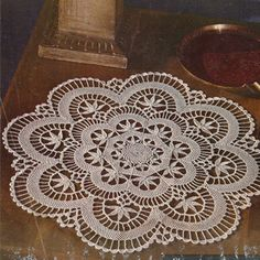 The crocheted Cluny doily design, 17 inches in diameter, is quite a lacy design with scalloped edges all the way around