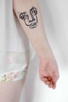 Este de su cara peculiar: | 33 Bellos tatuajes inspirados en artistas famosos