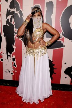 Pin for Later: Over 250 Celebrity Halloween Costumes!  Ashanti attended Heidi Klum's Halloween party as a sexy belly dancer in 2014.