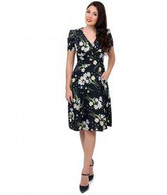 A forties floral should be second nature, darling! Fresh from Hell Bunny in bright hues of yellow, blue and green set ag...Price - $70.00-bI6ozatc