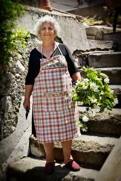 Portrait of an old woman in a garden with flowers in Amalfi, Italy © John Bragg Photography