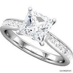 My dream engagement ring. Princess cut diamond, white gold and smaller diamonds around the band.