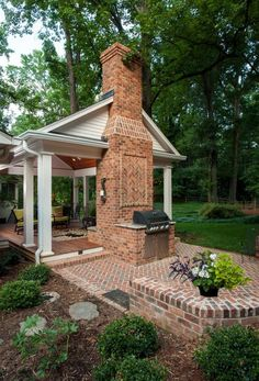 A backyard retreat with covered porch and open patio. Wood burning fireplace and grill area. Ipé decking for porch floor.