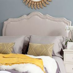 """Create a stylish focal point in your master suite or guest room with this lovely headboard, showcasing an elegantly arching design and nailhead trim.   Product: Queen headboardConstruction Material: Steel, metal, foam and linenColor: Taupe and nickelFeatures: Arching designNailhead trim Dimensions: 54.1"""" H x 61.8"""" W x 3.5"""" D Note: This product is a headboard only. Full bed is pictured for illustration purposes only.   Cleaning and Care: Spot clean onlyAssembly: Assembly required"""