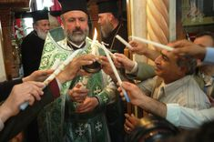 Greek Orthodox Easter   Residents Lighting candles at the Greek Orthodox Church in Beit Sahour ...