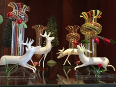 Four milk glass deer with Fadenglas vases. The leaves or mushrooms in front of the deer would support a place card or little menu. Glass Ornaments, Milk Glass, Mushrooms, Vases, Glass Art, Deer, Place Cards, German, Deutsch