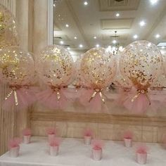Pink and gold theme christening with our signature confetti and tulle balloons…