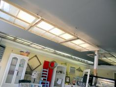 cover ugly fluorescent light fixtures with privacy film coated windows. - Home Decorating Magazines Florescent Light Cover, Barn Renovation, Up House, Big Girl Rooms, Light Covers, Window Coverings, Renting A House, Modern Lighting, Decoration