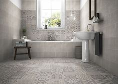 An eclectic design of warm grey patterns, a clever mix of organic vintage patterns alongside timeless geometric patterns.  Contemporary interpretation, expanding the geometric and retro detailing. Bathroom floor and wall tiles, Skyros Delft Grey  #bathroompattern