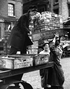 World War Two Home Front. A woman delivery boxes full of fish to traders in Billingsgate market, London September 1943 #Vintage #Art #Retro #London #LDN #Gift #Print #Photo #Photograph #Wall #Art #Old #BlackandWhite #WW2 #Women