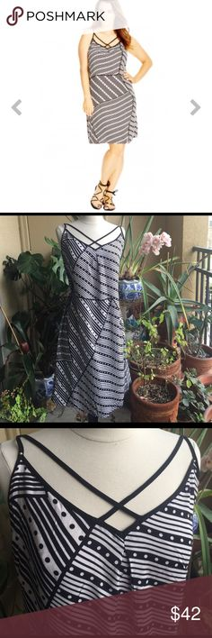 Criss cross Polka Dot Lined Black and White dress Can't really go wrong with City Chic! They are an amazing quality brand. This is the perfect summer dress. Its thin, cotton, has the white color and the fun geometric play. Very pretty dress. Not too skin hugging and not too flowy, it is just right. Never worn! Has a tag still attached. Note the photos are a mix of actual product and how it looks on the model. It was hard to see how it falls on a mannequin that isn't 2x size. Also for sizing…