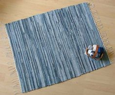 Just like your favorite blue jeans, which go with everything, this blue denim rug will go well in most any décor. Like many of my woven items, this rug recycles used clothing into a new functional piece of art; it is made entirely from old blue jeans. Weaving Yarn, Hand Weaving, Homemade Rugs, Denim Rug, Recycle Jeans, Upcycle, Sheepskin Rug, Weaving Projects, Custom Rugs