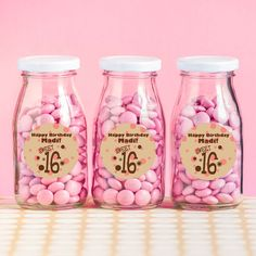Fill personalized milk bottles with candy and decorate your Sweet 16 Table!