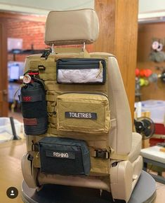 How do you stay organized in your vehicle? Seatback Panels come in Black or Coyote with a ton of storage options from GP Pouches to First Aid Kits and Fire Extinguisher Pouches. Overland Gear, Overland Truck, Tactical Truck, Tactical Gear, Truck Mods, 4x4 Trucks, Truck Camping, Truck Tent, Land Cruiser
