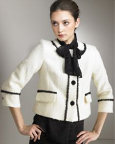 Chanel Jacket. The Chanel suit, inspired by men's wear, was composed of solid or tweed fabric. Usually using Black White.