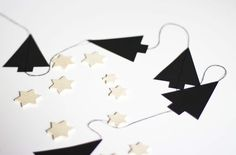 Christmas is getting so much closer now, but I'm still enjoying making some decorations for around the house. I made this garland with black Christmas trees I cut out of paper, which I sewed together with some black thread.