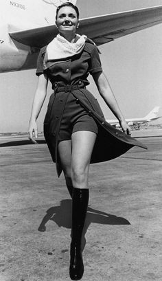 A TWA stewardess models the new uniform with knee-high boots that the airline has introduced in New York City, June The TWA mini pants will be worn with a safari shirt dress. (AP Photo) ORG XMIT: [Via MerlinFTP Drop] Air Hostess Uniform, Hippie Man, Safari Shirt, Flight Attendant Life, M Photos, Attendance, Vintage Photos, Retro Fashion, Packing Tips