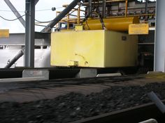 One of our large Suspension Electro Magnets installed over a conveyor at a bulk handling terminal in Indonesia. The Magnet is removing tramp ferrous metal prior to ship-loading #Export #ukmfg Magnets, Ship, Metal, Design, Ships, Metals