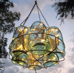 Mason jar chandelier...jars in a canner rack with string lights, perfect summer lighting!