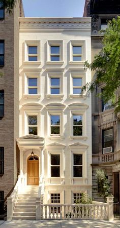 Five story white stone brownstone house. home design inspiration. White house with pretty window trim, light wooden front door, steps. Pretty front stoop and entryway design. Architecture Design, Architecture Classique, Building Architecture, Building Exterior, Beautiful Buildings, Beautiful Homes, Beautiful Things, City Living, My Dream Home
