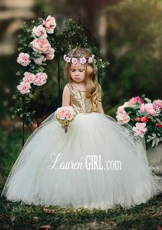 Our most popular flower girl dress, Giselle! This dress is created with gold sequin bodice with ivory tulle skirt. Your little princess flowers girls will sparkle with excitement at your lovely wedding. To Order: Choose Size In Notes Include: Custom Colors if desired Custom Lengths (measured from center top of shoulder