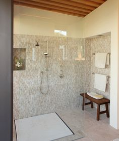 Coastlands House, California. The large, open shower of this Big Sur home transitions gracefully to a spacious bathroom thanks to the Omvivo flush drain!