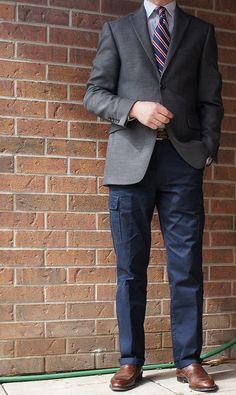 Dark grey jacket, white shirt, navy tie with red & white stripes, navy pants