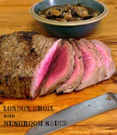 London Broil with Mushroom Sauce | www.takingonmagazines.com | Marinated in a delicious garlic and mustard combination and topped with tasty mushrooms, this London Broil with Mushroom Sauce is a rich and delicious meal.