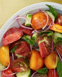 Soak sliced red onion in red-wine vinegar to give it a pleasingly tangy punch. Add the onion to a colorful summer salad of tomatoes, cucumber, and fresh basil leaves.