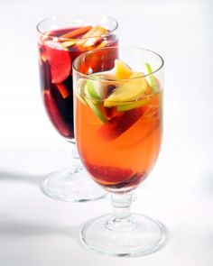 Red Sangria:  Ingredients  1 cup brandy 1 orange (ends cut off), thinly sliced 1 red apple, halved and thinly sliced 2 bottles well-chilled dry red wine, such as Rioja or red Zinfandel 1 cup club soda 3/4 cup fresh orange juice Directions  In a large pitcher, stir together brandy, orange and apple slices. Let stand 15 minutes. Add wine, club soda, and orange juice. Serve over ice. marthastewart.com for more great recipes!