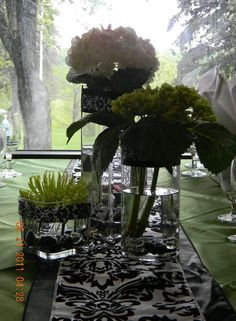 Love the combination of clover green with black and white. We used white and green hydrangeas along with a green spider mum for this centerpiece
