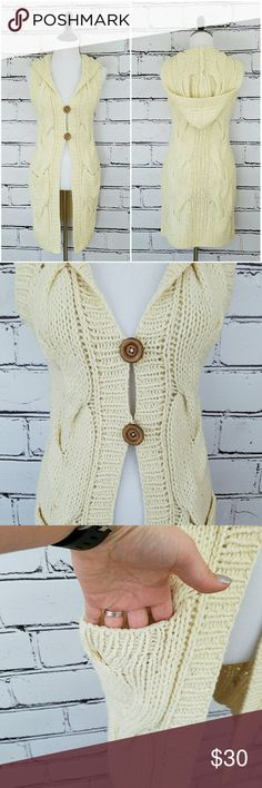 Free People Long Hooded Sweater! Long cream colored cable knit sweater. 2 large wooden buttons and 2 front pockets. Hooded. Length is about 35 inches and armpit to armpit is about 16 inches. Great condition! Free People Sweaters Cardigans