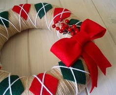 Ha ha ha! Doesn't this look like a vintage sweater? Perfect traditional holiday look! Red and green diamonds with white criss-crossing against a tan background, a classic topped off with a red bow and berry branches!  Perfect on your front door, in your kitchen or on your wall!