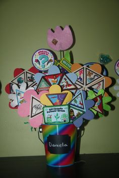 Badge Display for awards ceremony-- So Cute!!!- site has good links to meeting and badge ideas.