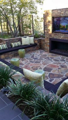 Super fun outdoor space complete with surround seating, fireplace and over-size TV.