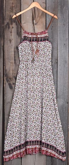 You can't get any better than a paisley printing dress with crochet details for summer! The elastic at waist will accentuate your waist and elongate your frame. It looks perfect paired with flat sandals.