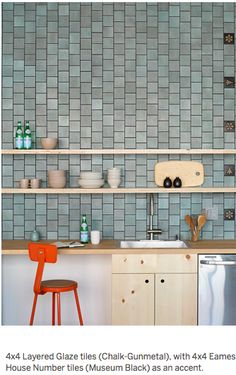 love the tile and the color combination (tile/light cabinets and shelves w/ pop of orange)