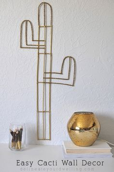 Easy Cacti Wall Decor! Inspired by CB2 but nearly a FREE DIY to create. Delineateyourdwelling.com